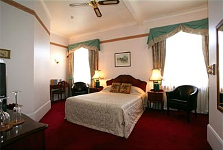 It sure looks like a deluxe suite, but this is merely one of the 13 standard rooms at our exclusive hotel in Napier.