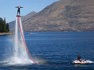 One of the more unusual sights on the lake at Queenstown - a man riding on top of a jet of water.