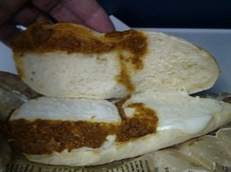 Yes, this does look like a something-stain on this roll, doesn't it.  But it is simply another tasty morsel of airline food - see last item, below.