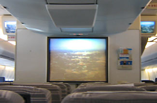The not-so-good older days of airline travel - the in-cabin movie screen.