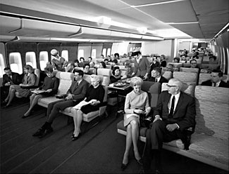 This Pan Am publicity shot of one of their new 747 planes is interesting - if you count the seats, you'll see that originally the 747 had only nine seats per row in coach class. Subsequently, the airlines squeezed in ten per row.
