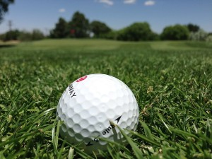 close up on golf ball on the fairway