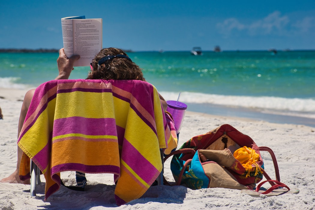 A woman reading at the beach.