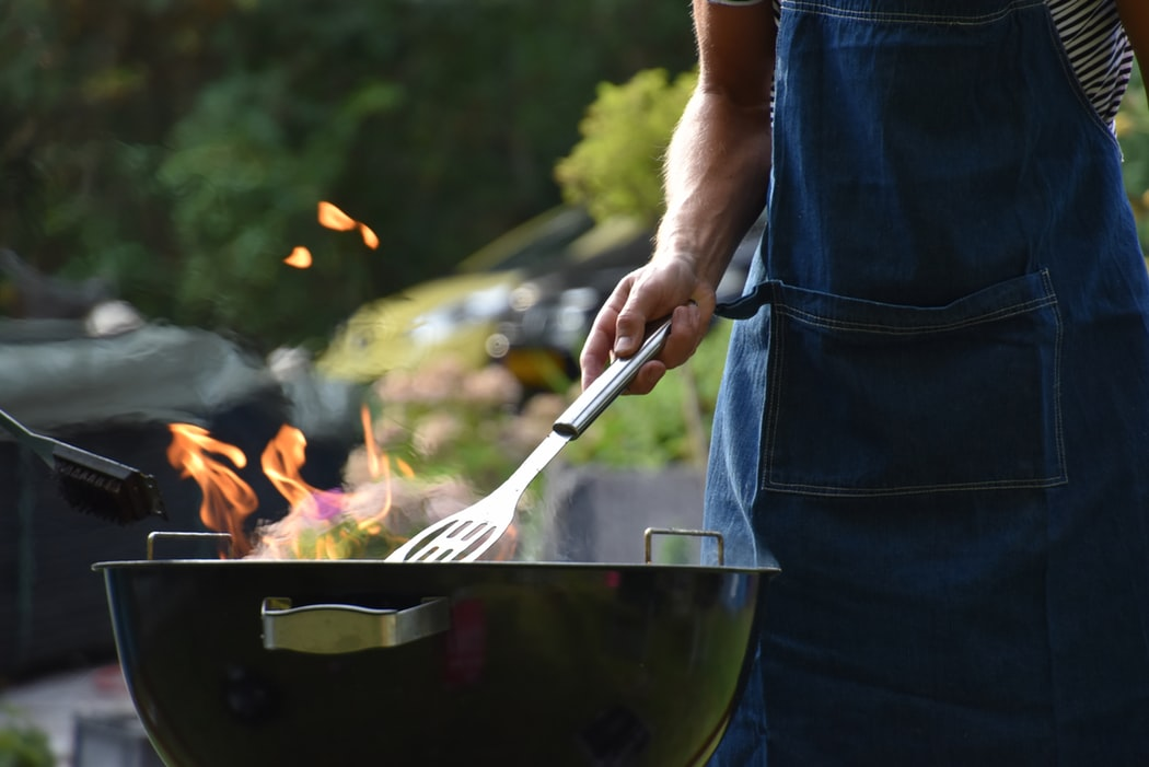 A man grilling.
