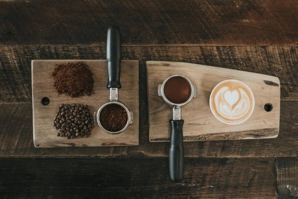 Various coffee-making ingredients on a wooden board.