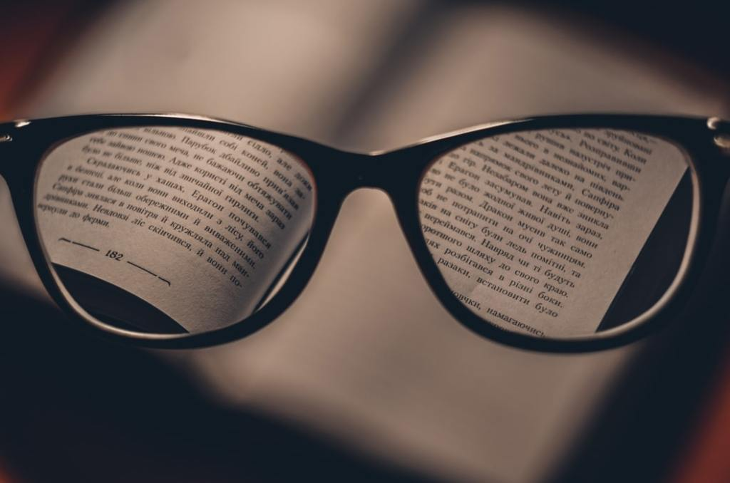 Glasses looking at a page with a foreign language in focus.