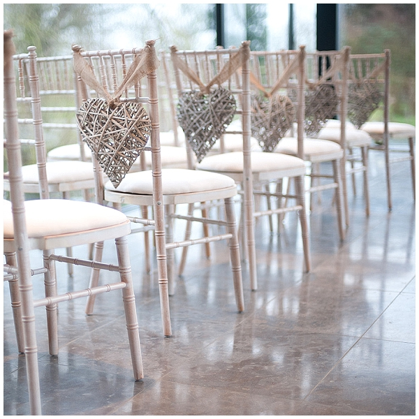 burlap chair covers ideas pb desk chairs pink and gold wedding inspiration decorations hessian ribbon on wicker hearts for pew ends