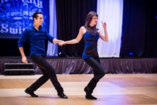 Hugo Miguez and Rachel Dotter perform their Pro-Am routine at River City Swing 2016. Photo Cred: Ariel Penu