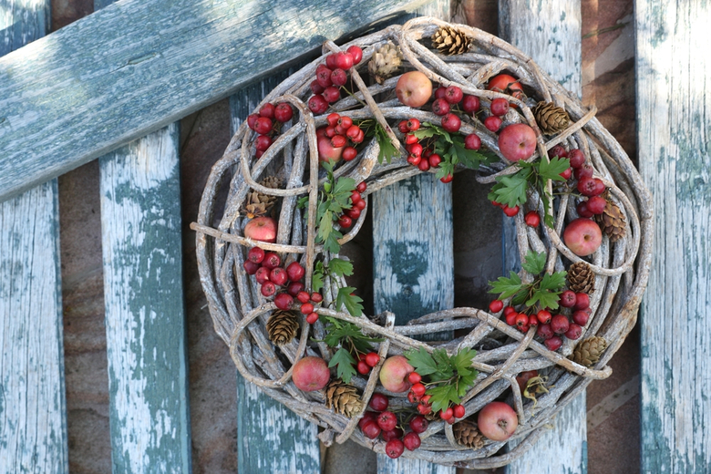 Wooden wreath with berries and leaves