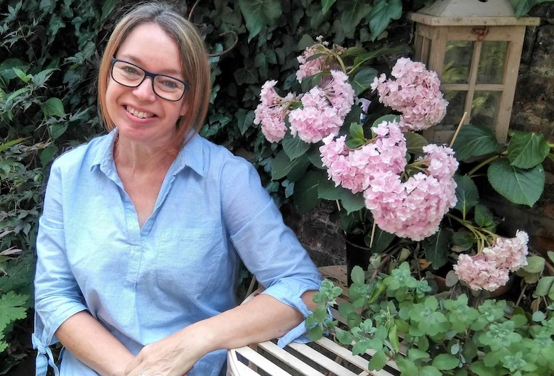 Jane Kelly sitting in the garden
