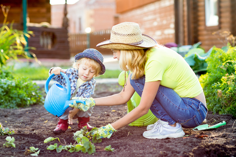 Mother and son gardening in the vegetable plot