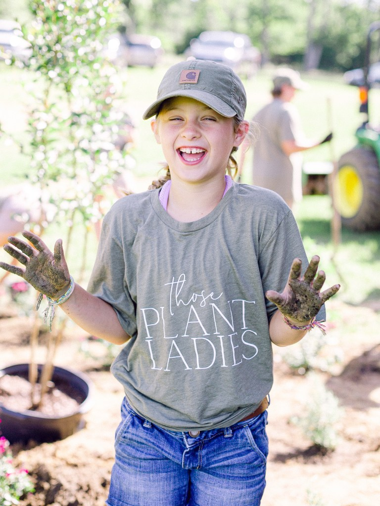 One of the youngest TPL crew members at a Those Plant Ladies landscape installation.