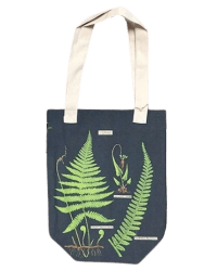 Fern tote bag from Those Plant Ladies. Navy background with green ferns; neutral straps.