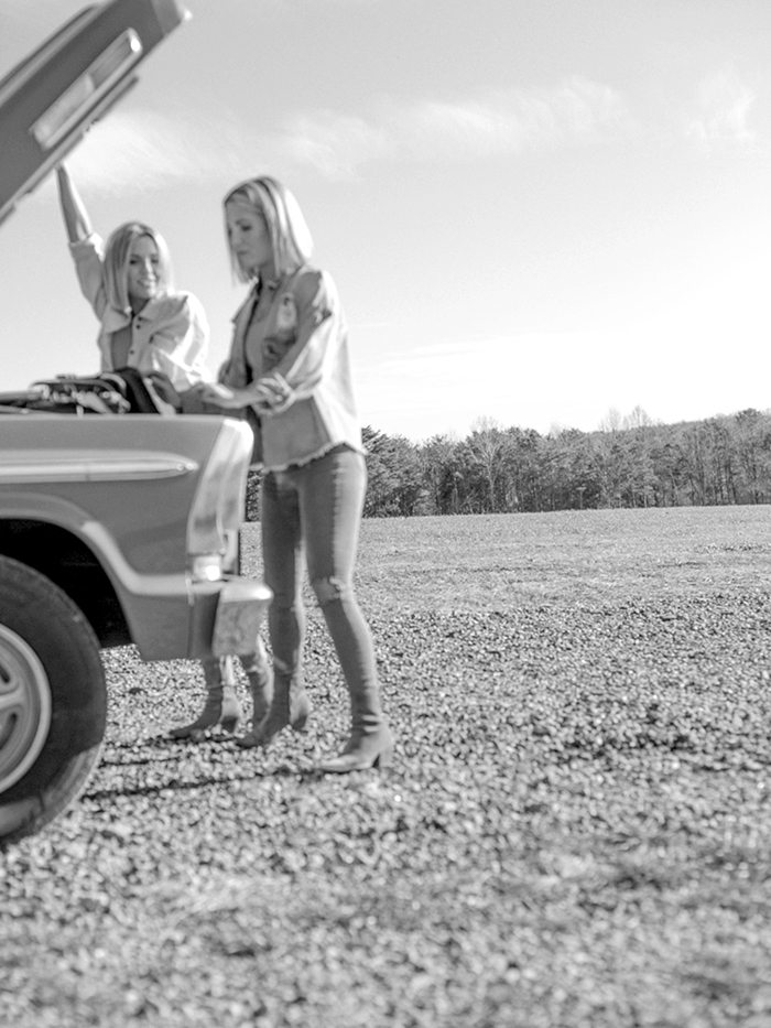 Fawn and Heather from Those Plant Ladies working on a pickup truck.