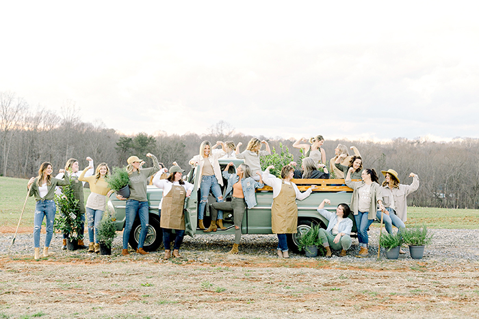 Those Plant Ladies with the vintage green Ford pickup truck and the signature muscle pose.