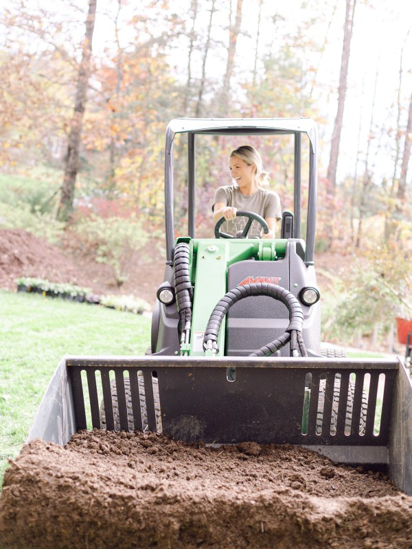 Fawn of Those Plant Ladies driving the Avant Loader 630 at a landscape installation.
