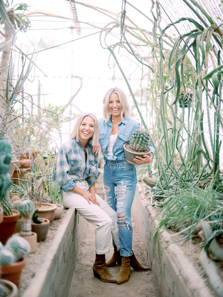 Heather and Fawn of Those Plant Ladies surrounded by plants in California.