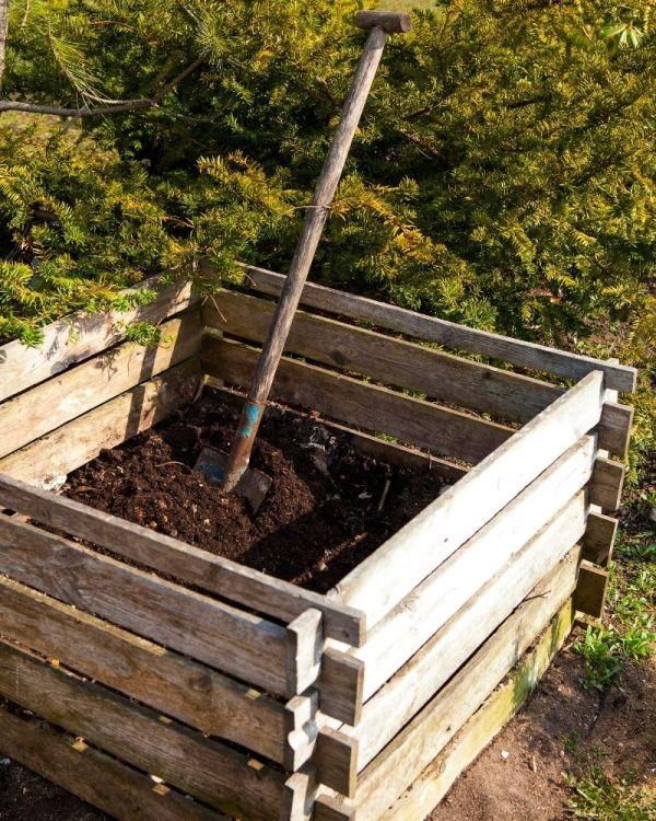A wooden compost bin.