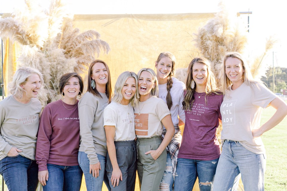 A crew of Those Plant Ladies all in branded tees.