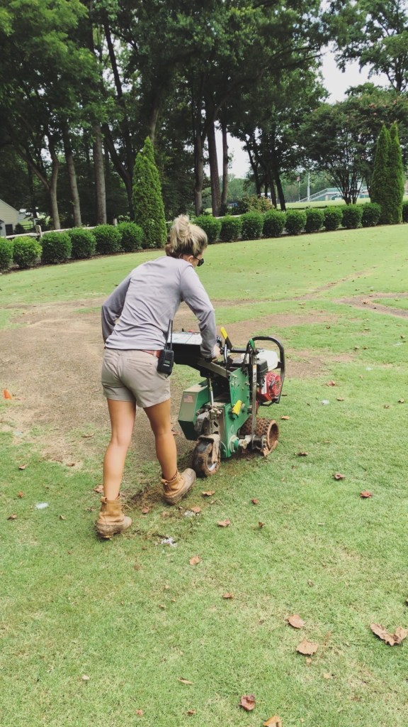 Fawn Wilson of Those Plant Ladies seeding grass.