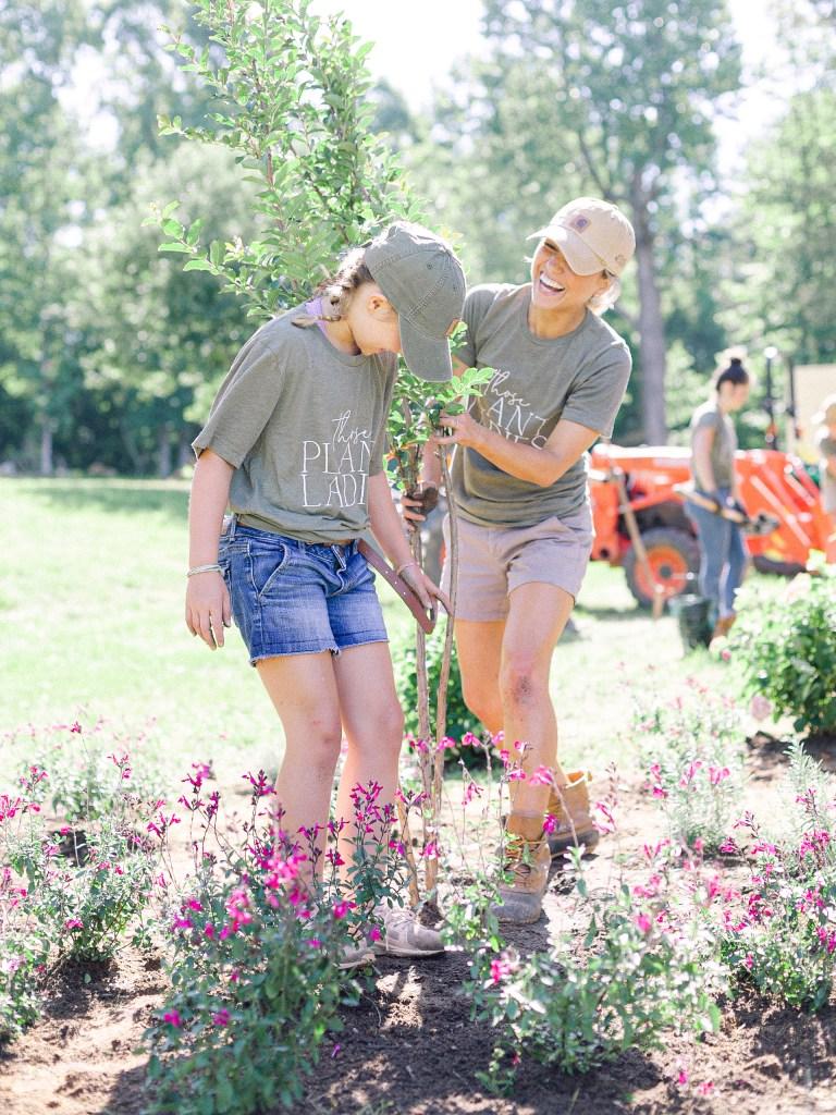 Members of Those Plant Ladies having fun and installing plants.