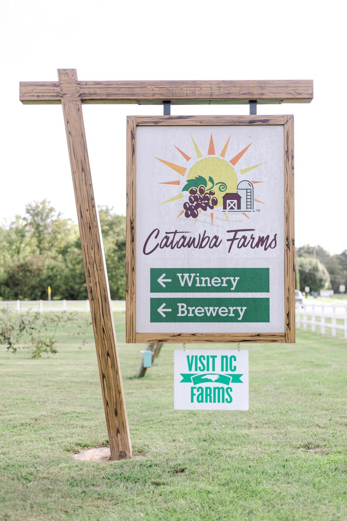 A wooden sign for Catawba Farms Winery and Brewery.