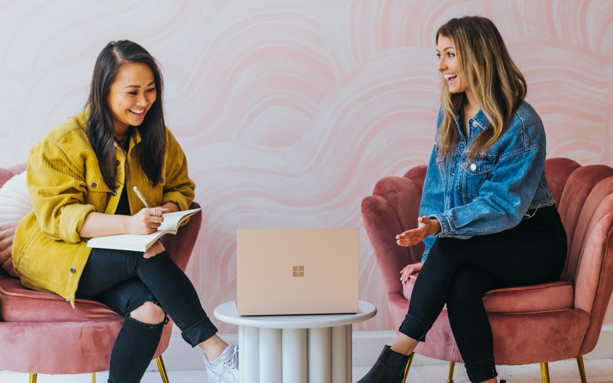 two women consulting on office design in their workplace