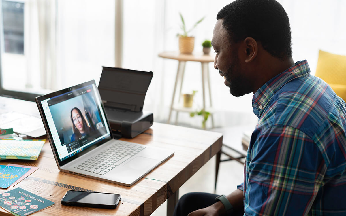 employee engaging with colleagues in a hybrid workplace