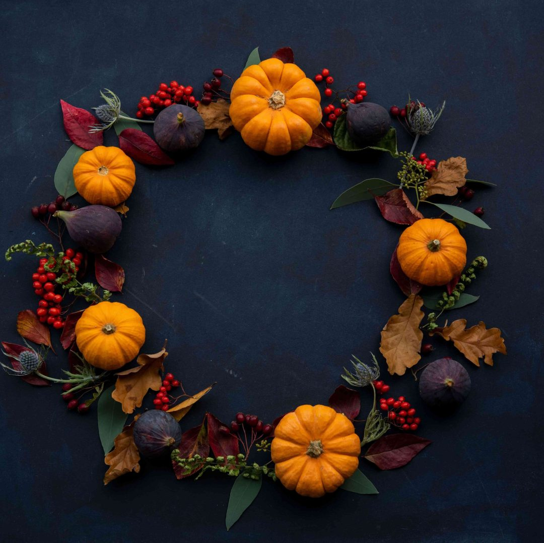 Wreath made of pumpkins and leaves