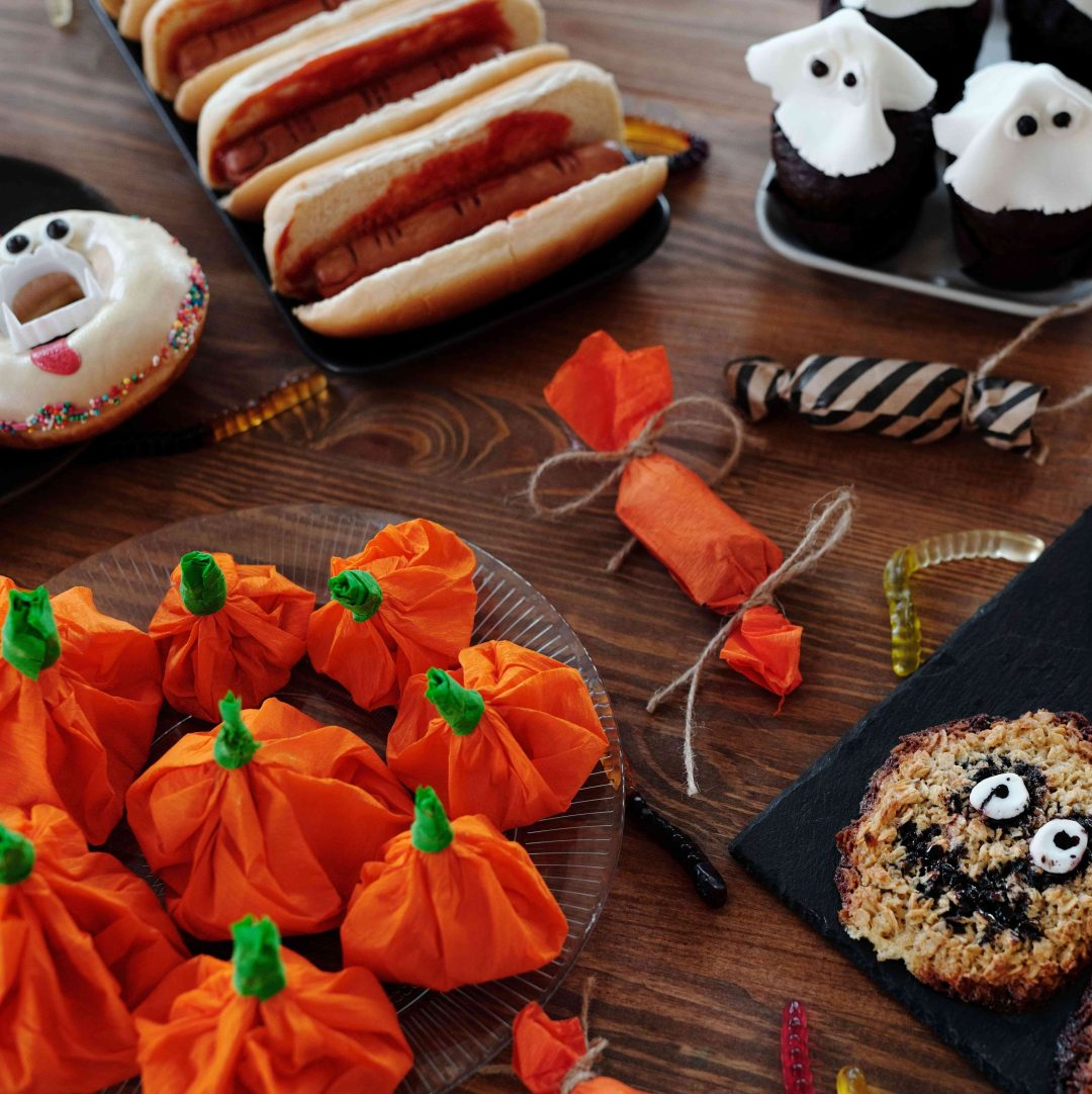 Halloween-themed snacks, vampire donuts, ghost cupcakes and pumpkin candies