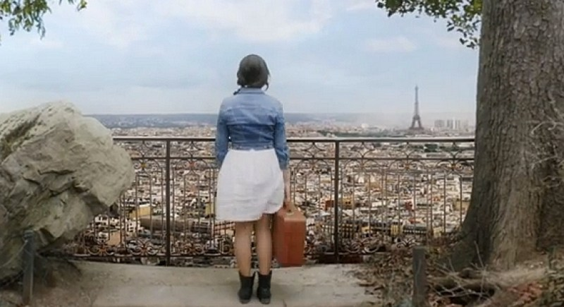 "Indila looking at Paris in the music video, ""Dernière Danse"""