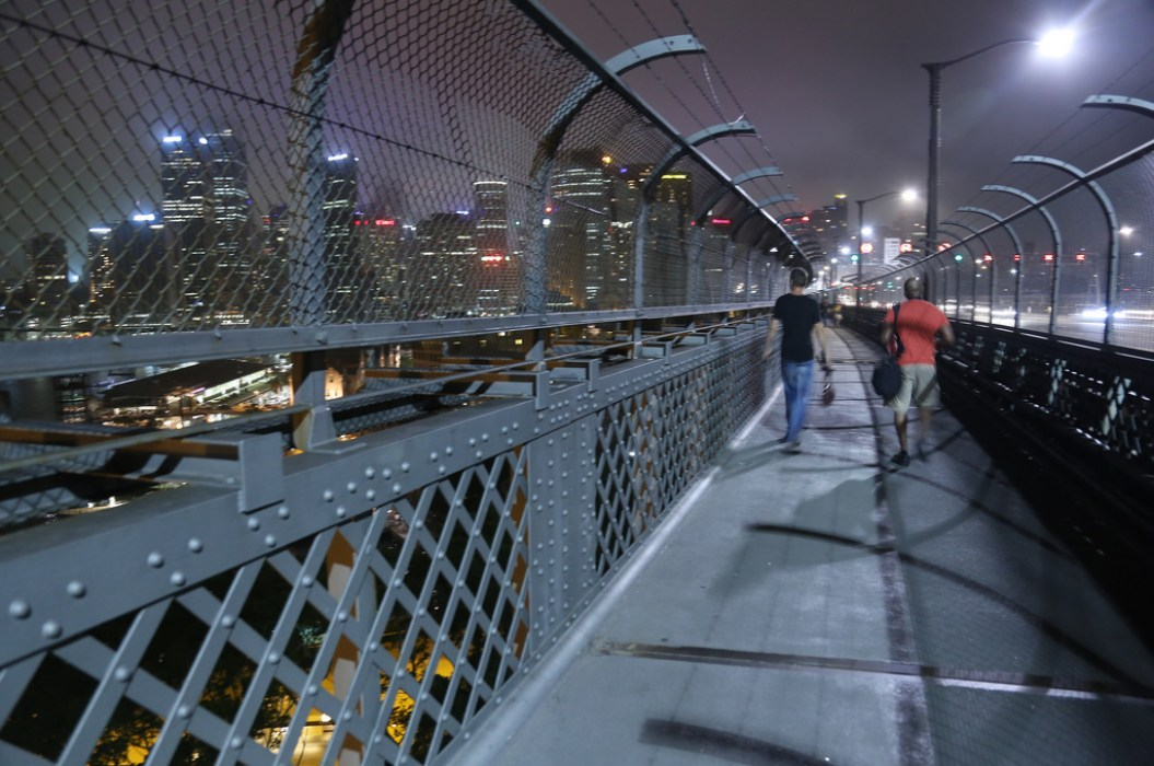 """""""Two Photographers Looking for that Perfect Shot"""" / Richard and Tosin walking across Harbour Bridge in Sydney / Photo Courtesy of Richard's Lovely Wife"""
