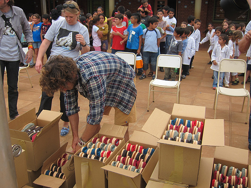 Blake Mycoskie unpacks a shipment of shoes for schoolchildren in Argentina Photo courtesy of andysternberg.
