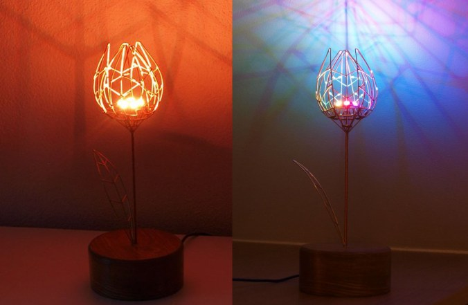 An electromechanical tulip made from brass rods and LEDs. Side-by-side shots show it in red and blue.