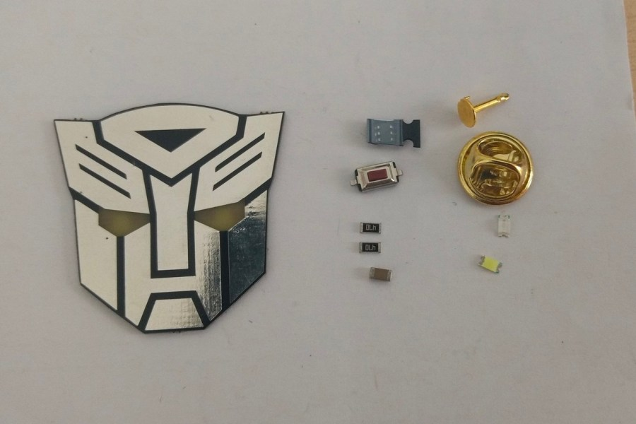 Suit up and Roll Out With This Pin Badge