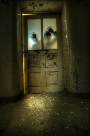 Zombies clawing at a door