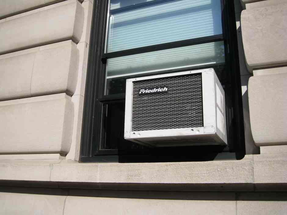 Image of window AC unit. Replacing your air conditioner filter is easier than you think.