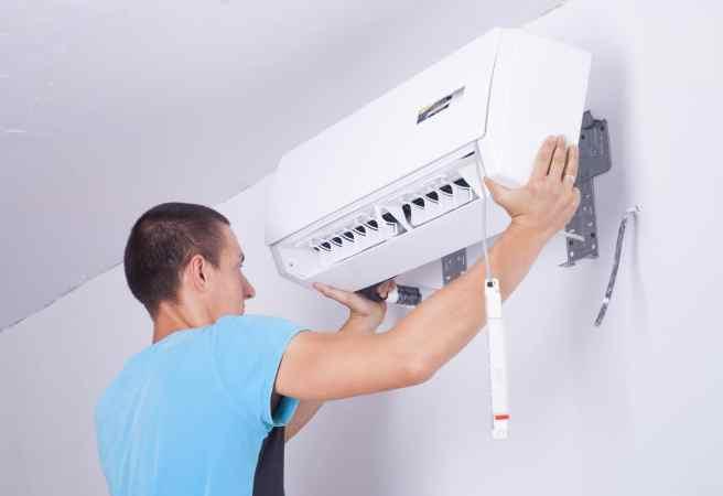 Image of man installing a mini split indoor unit