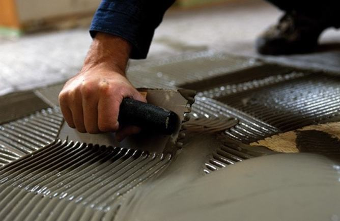 Image of Nuheat floor mat installation.