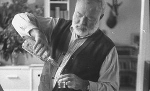 Hemingway pours himself a drink