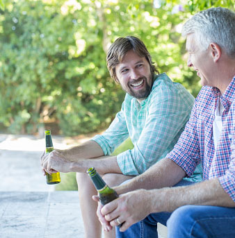 Father and son drinking outdoors