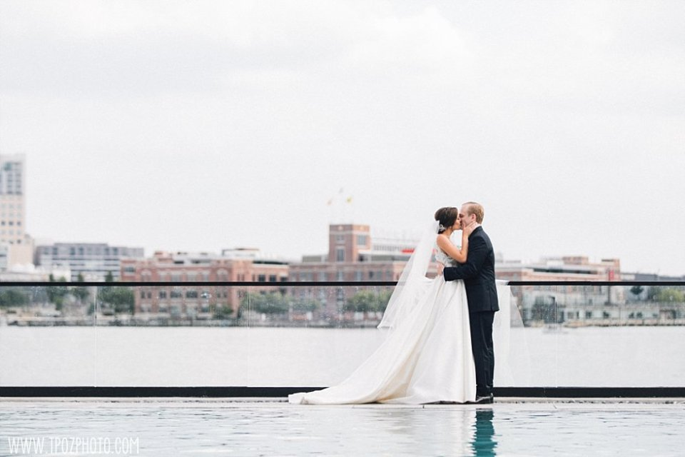 Sagamore Pendry Pool wedding photos bride & groom kissing •  tPoz Photography • www.tpozphoto.com