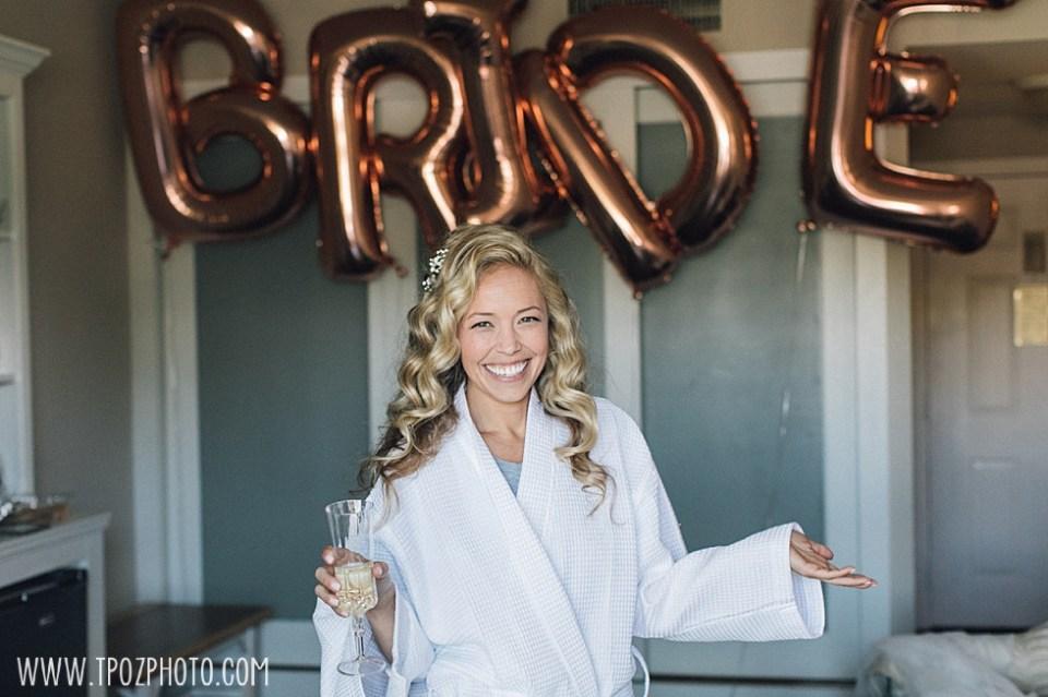 bride popping champagne at St Michaels Harbor Inn