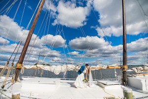 Bride+Groom on a boat at Chesapeake Bay Maritime Museum wedding