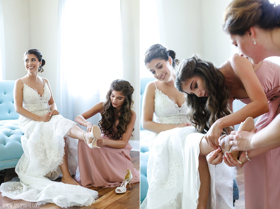 Sister is putting on the bride's shoes in the Bridal Suite at Rosewood Farms