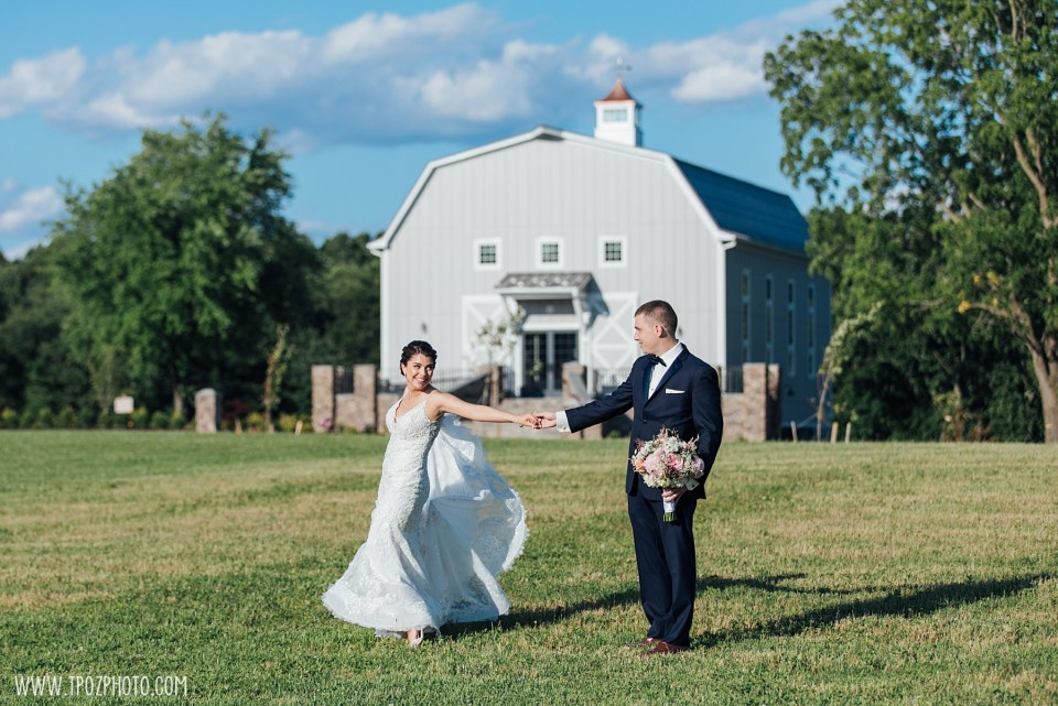 Groom twirling the bride at a Rosewood Farms wedding  - Maryland Wedding Photographer