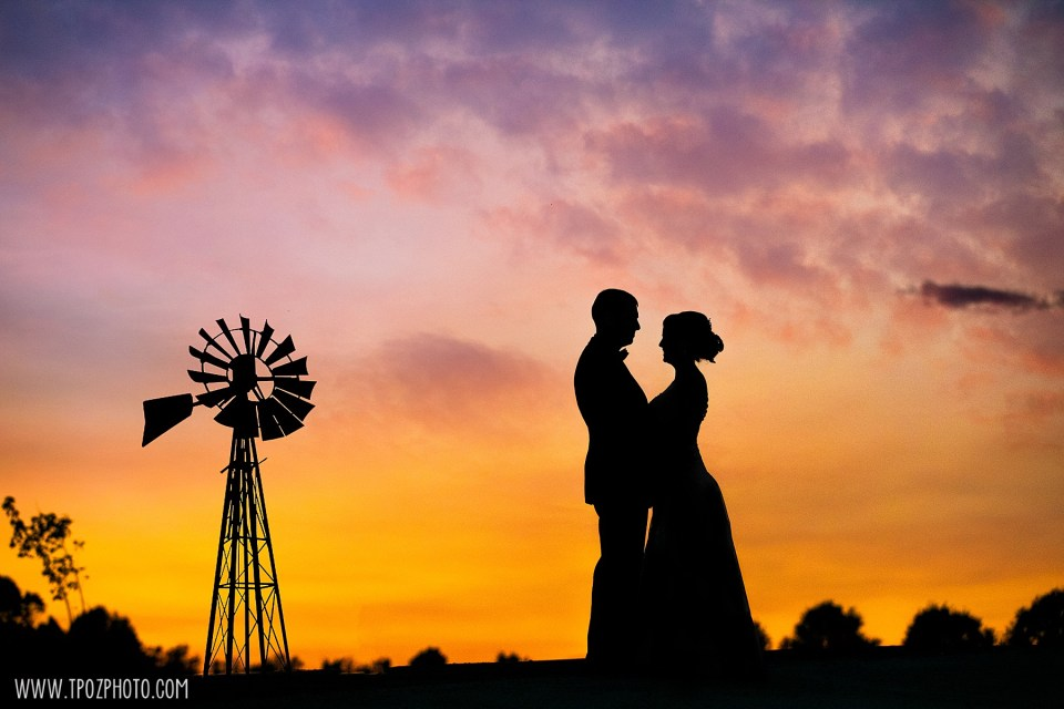Silhouette of a bride and groom and windmill during Sunset at a Rosewood Farms wedding  - Maryland Wedding Photographer