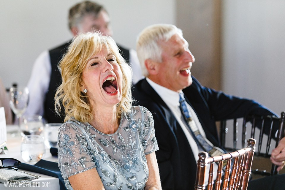 Mom laughing hysterically at a wedding speech