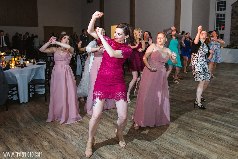 Girls doing the wobble at a wedding reception