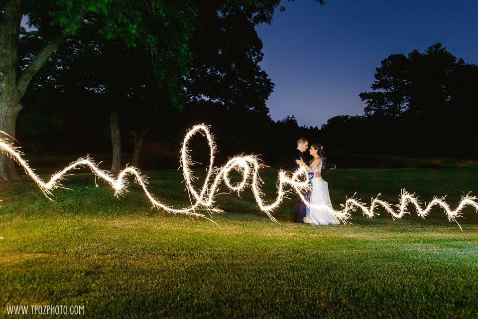 Rosewood Farms wedding couple, night photos writing LOVE with a sparkler  - Maryland Wedding Photographer